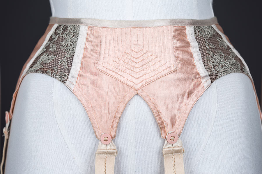 Quilted satin and embroidered tulle suspender belt - front panel close up. Photography by Tigz Rice Studios