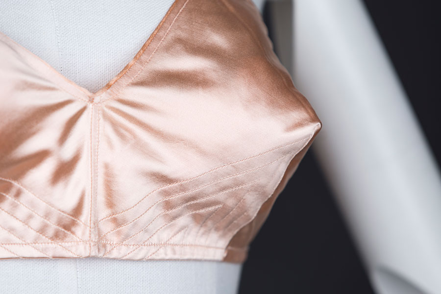 Satin quilted bra by Liberation - cup stitching and bust point.   Photography by Tigz Rice Studios