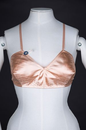 Satin quilted bra by Liberation - front view. Photography by Tigz Rice Studios