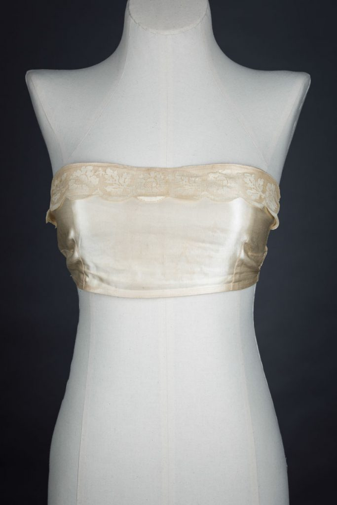 Satin bandeau bra with tripartate strapping by The Modishform, c. late 1910s The Underpinnings Museum shot by Tigz Rice Studios 2017