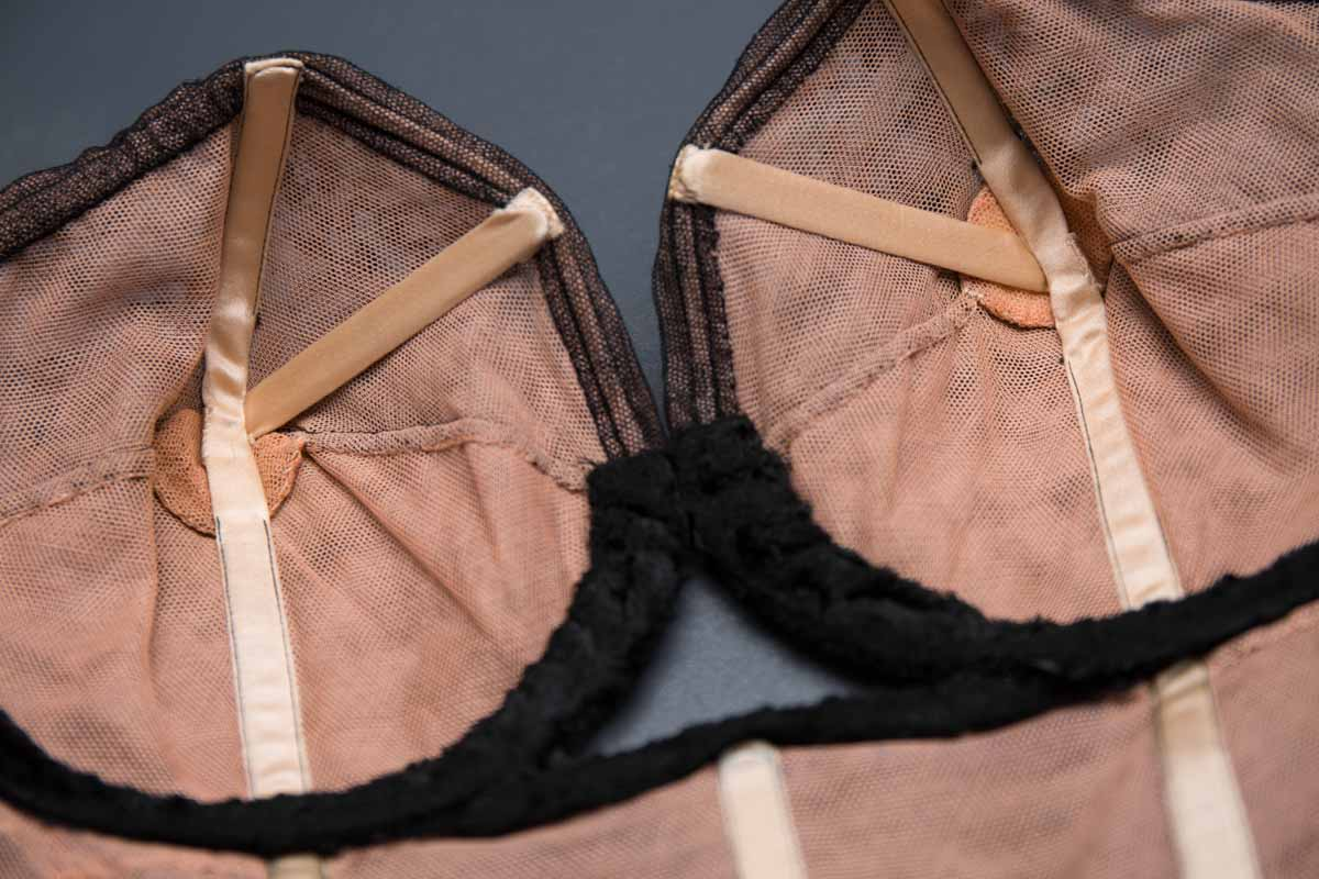 Strapless black lace structured bra by Cadolle, c. 1950s The Underpinnings Museum shot by Tigz Rice Studios 2017