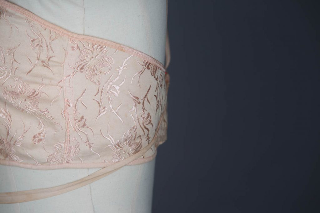 Floral jacquard wraparound bandeau bra, c. 1920s The Underpinnings Museum shot by Tigz Rice Studios 2017