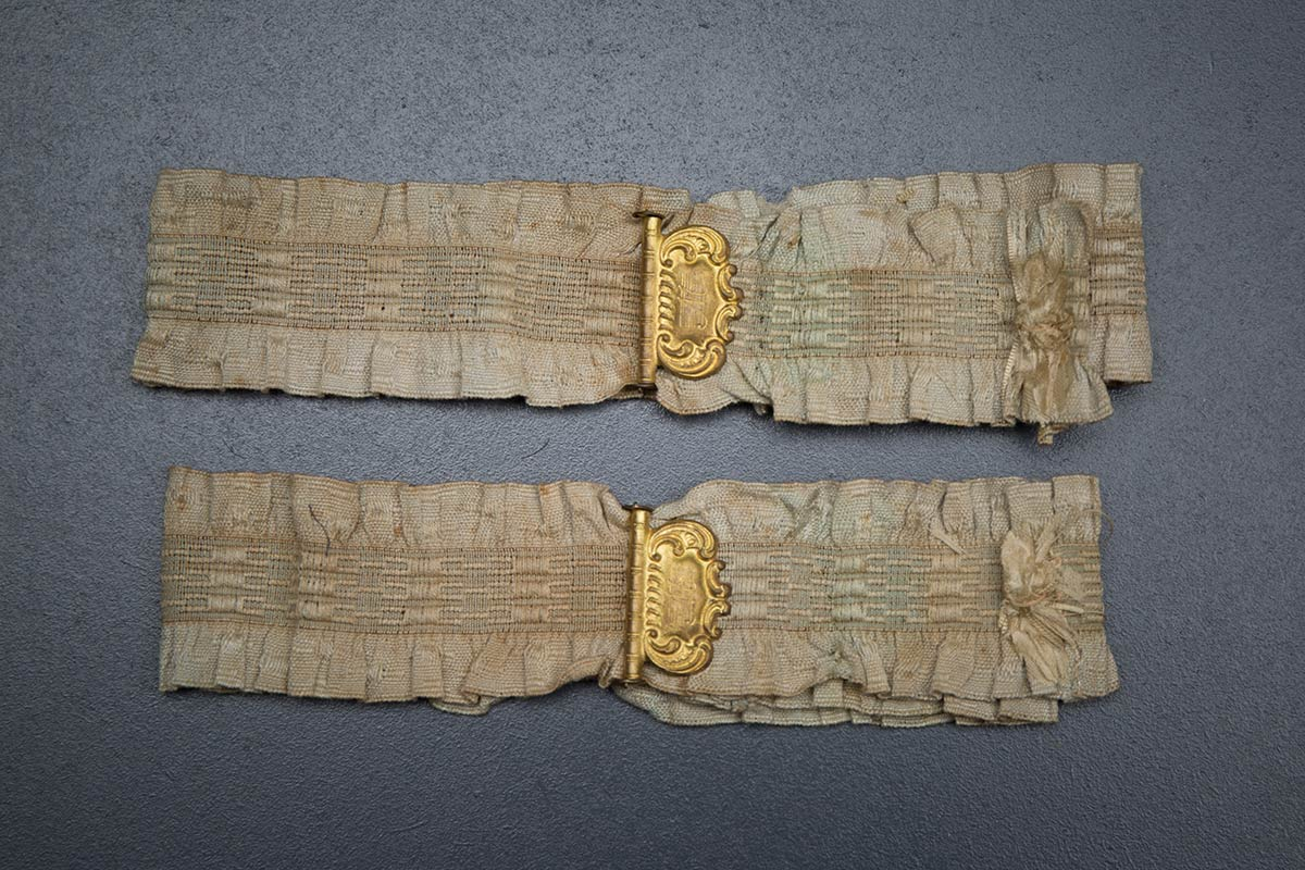 Ruffled elastic garters with gilt monogrammed adjusters, c. 1910s, USA. Photography by Tigz Rice Studios. From The Underpinnings Museum collection.