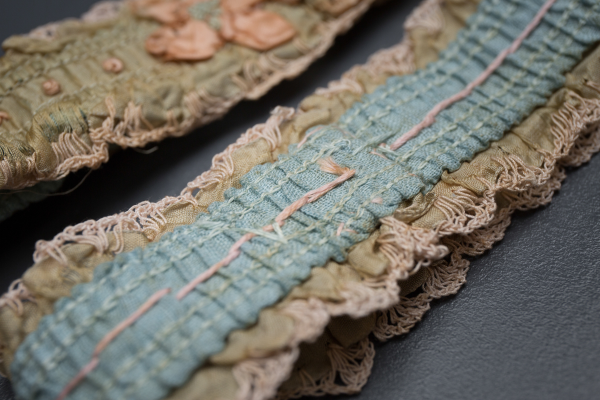 Green ribbon garters with crochet trim and French knot embroidery, 1920s, USA Photography by Tigz Rice Studios