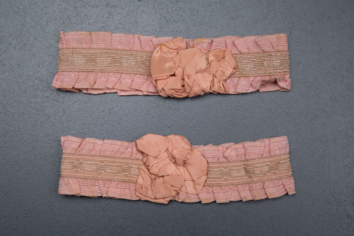 Pink ruffle elastic garters with silk rosettes, c. 1920s, USA Photography by Tigz Rice Studios. From The Underpinnings Museum Collection.