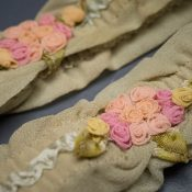 Green silk ribbonwork Bridal garters, c. 1930s, USA Photography by Tigz Rice Studios. From The Underpinnings Museum collection.