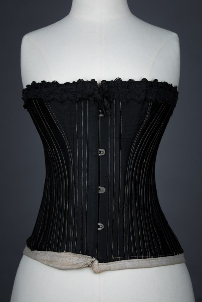 Black cotton working woman's corset, c.1900, Great Britain. The Underpinnings Museum, Photo by Tigz Rice