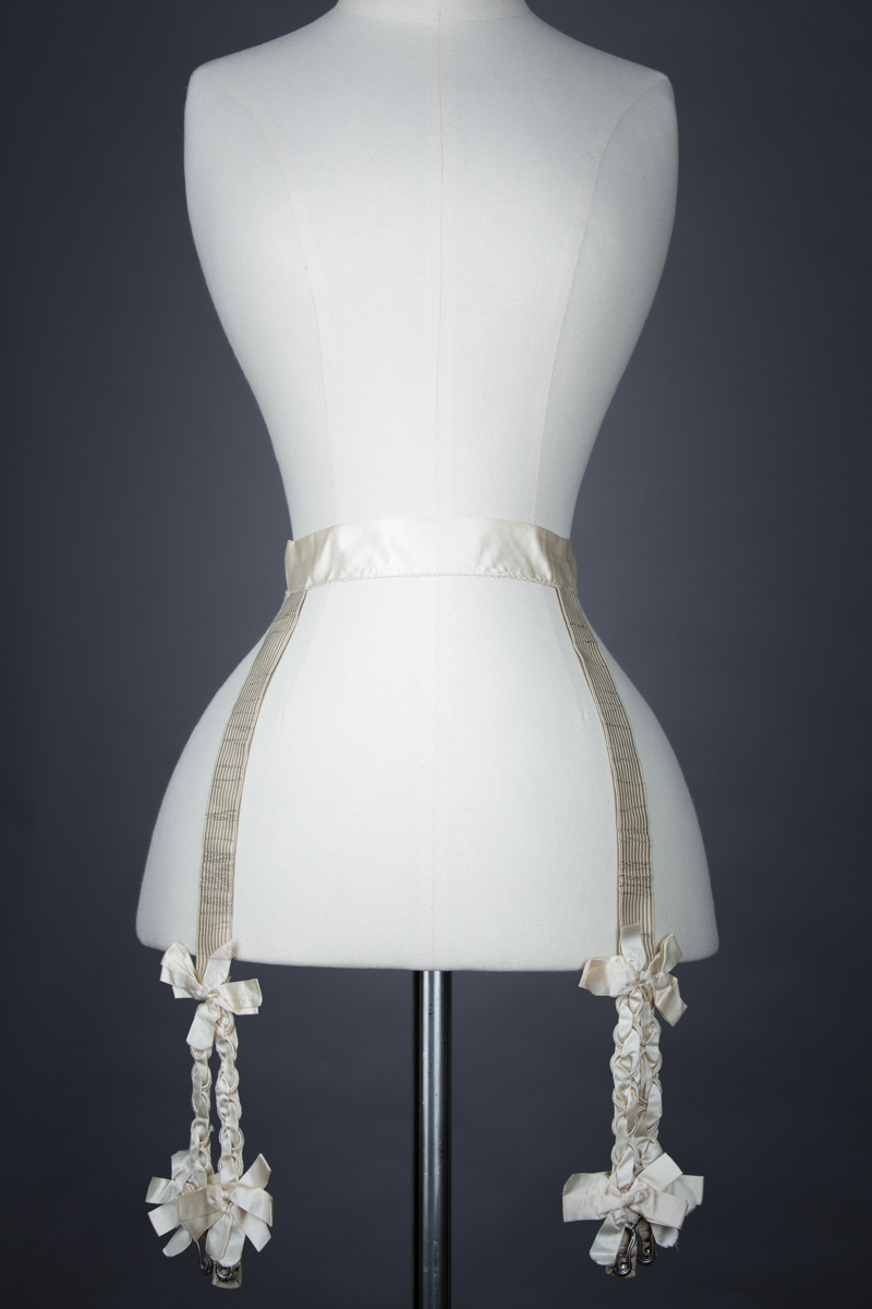 Cream Silk Hose Supporter Suspender Belt, c. 1900s. From The Underpinnings Museum collection Photography by Tigz Rice