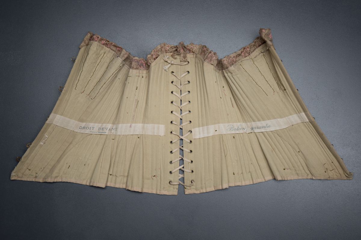 'Droit Devant Forme Nouvelle' Drab Coutil Corset With Flossing Embroidery, c, 1900-5, France. The Underpinnings Museum. Photography by Tigz Rice