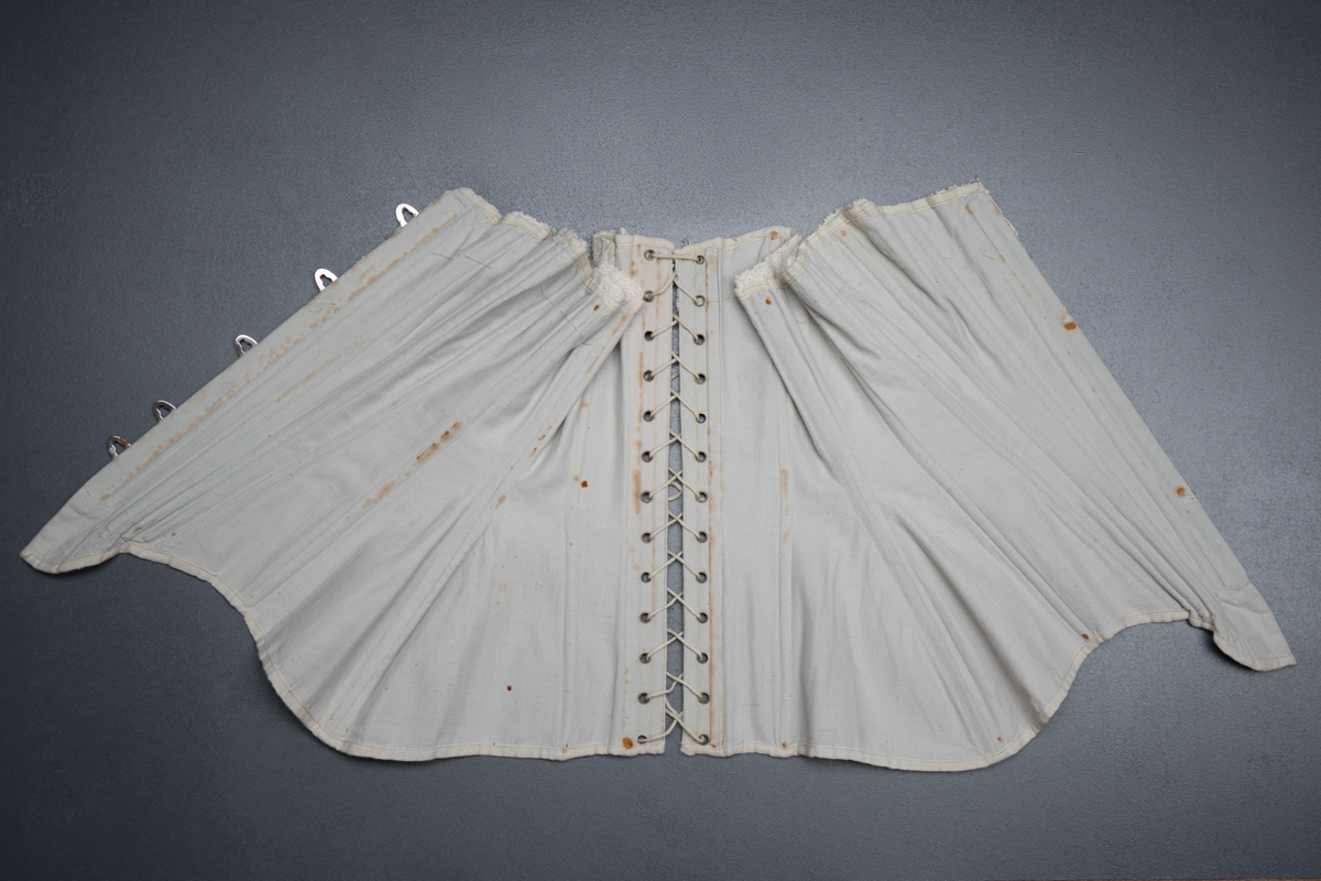Grey herringbone coutil corset with ribbonslot lace trim, c. 1900-5, France. From The Underpinnings Museum collection. Photography by Tigz Rice.