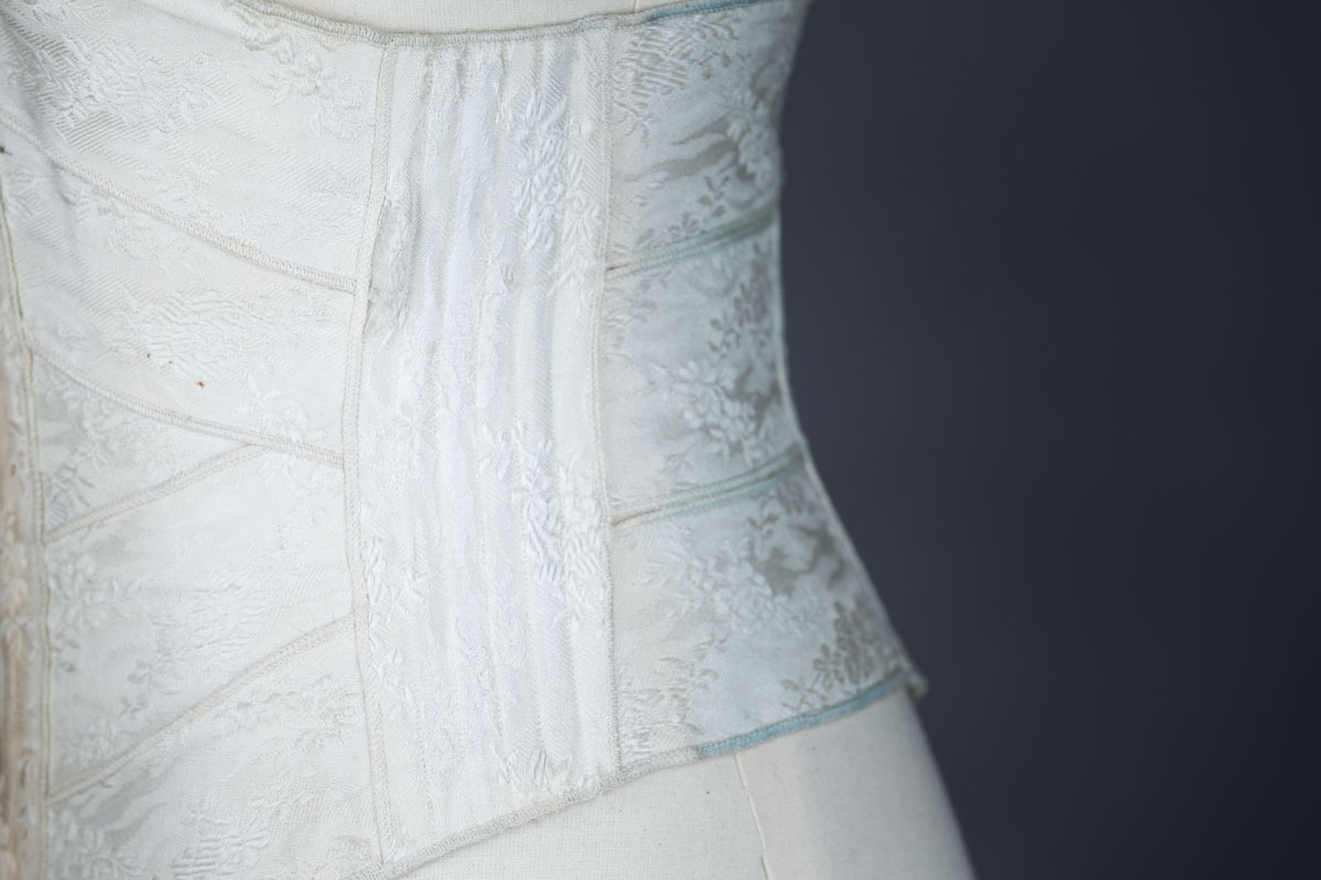 Overlocked Floral Jacquard Weave Ribbon Corset, c. 1900, Great Britain. The Underpinnings Museum. Photo by Tigz Rice