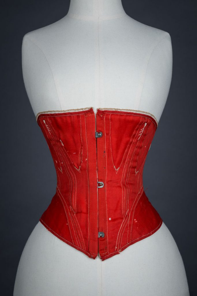 Red midbust corset with flossing and gores, c.1860s From The Underpinning Museum collection Photography by Tigz Rice