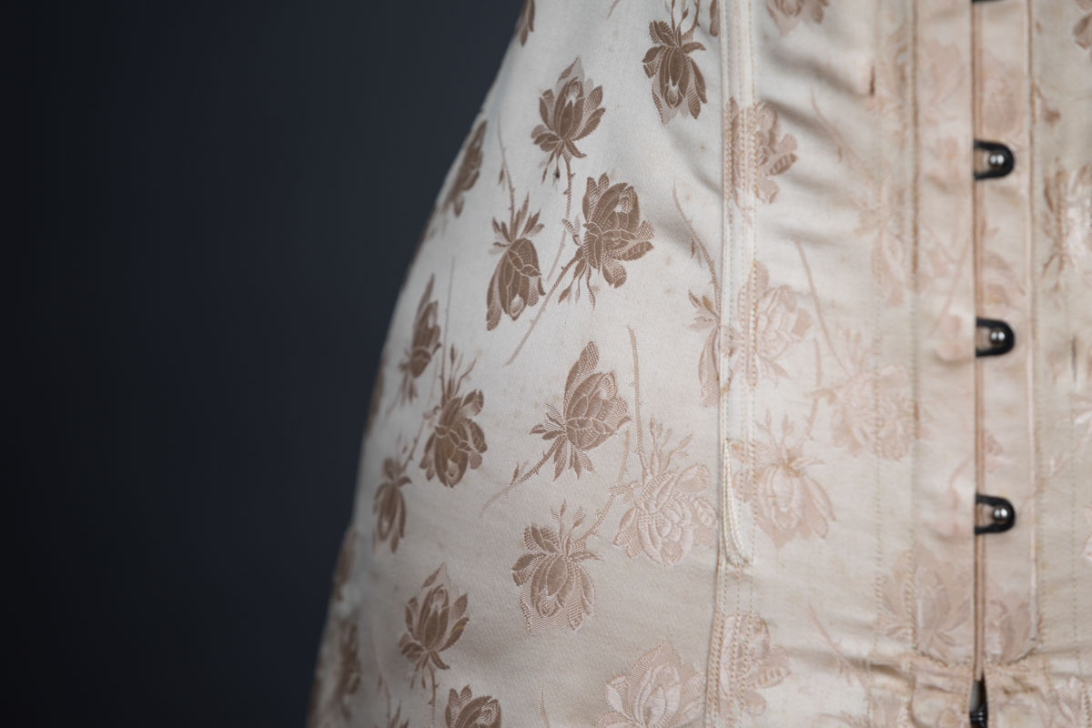 Floral silk wedding corset by Lafayette, c. 1910s, France. The Underpinnings Museum. Photo by Tigz Rice