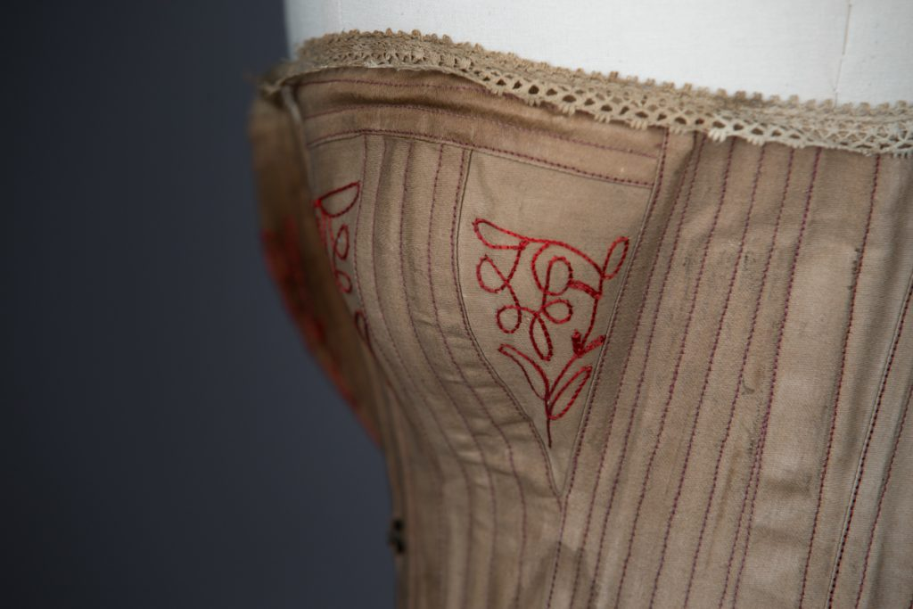 Brown cotton corset with embroidered bust gores, c. 1890s, USA From The Underpinnings Museum collection Photography by Tigz Rice