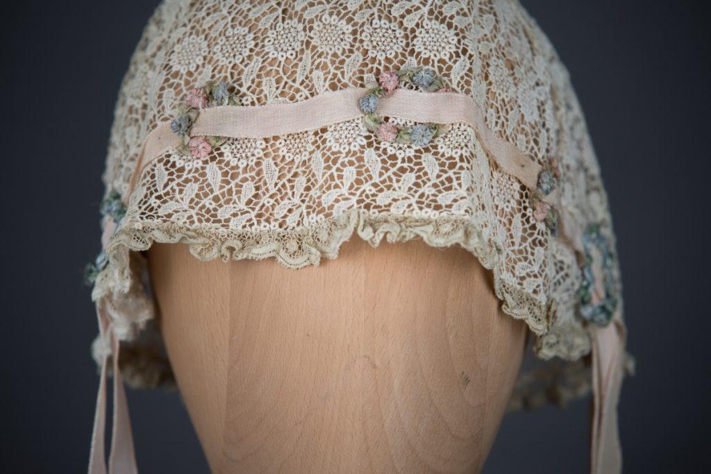 Chemical lace boudoir cap with ribbonwork, c. 1920s, GB, The Underpinnings Museum. Photo by Tigz Rice