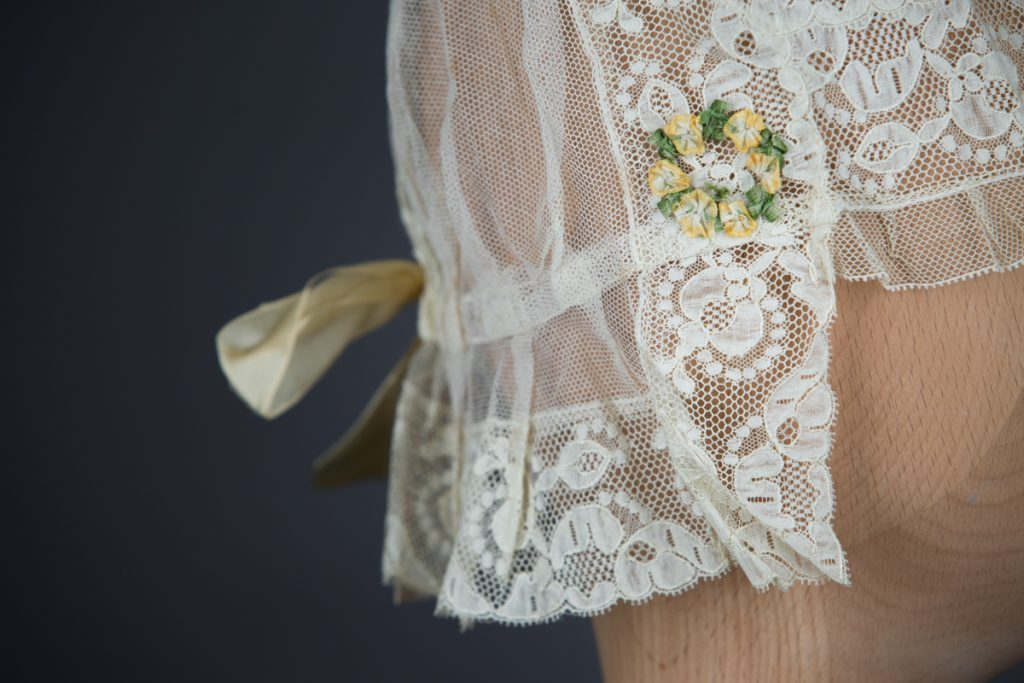 Lace, tulle and silk bow boudoir cap, c. 1910s, Au Bon Marché, France. The Underpinnings Museum, Photo by Tigz Rice