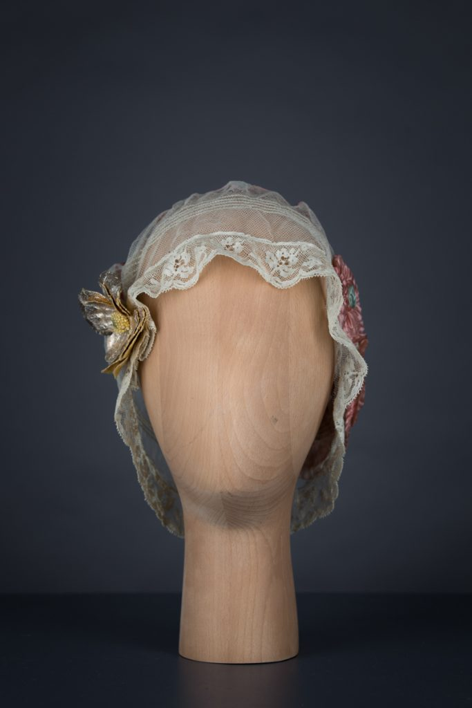 Tulle & silk boudoir cap with oversized flowers, c. 1920s, USA. The Underpinnings Museum. Photo by Tigz Rice