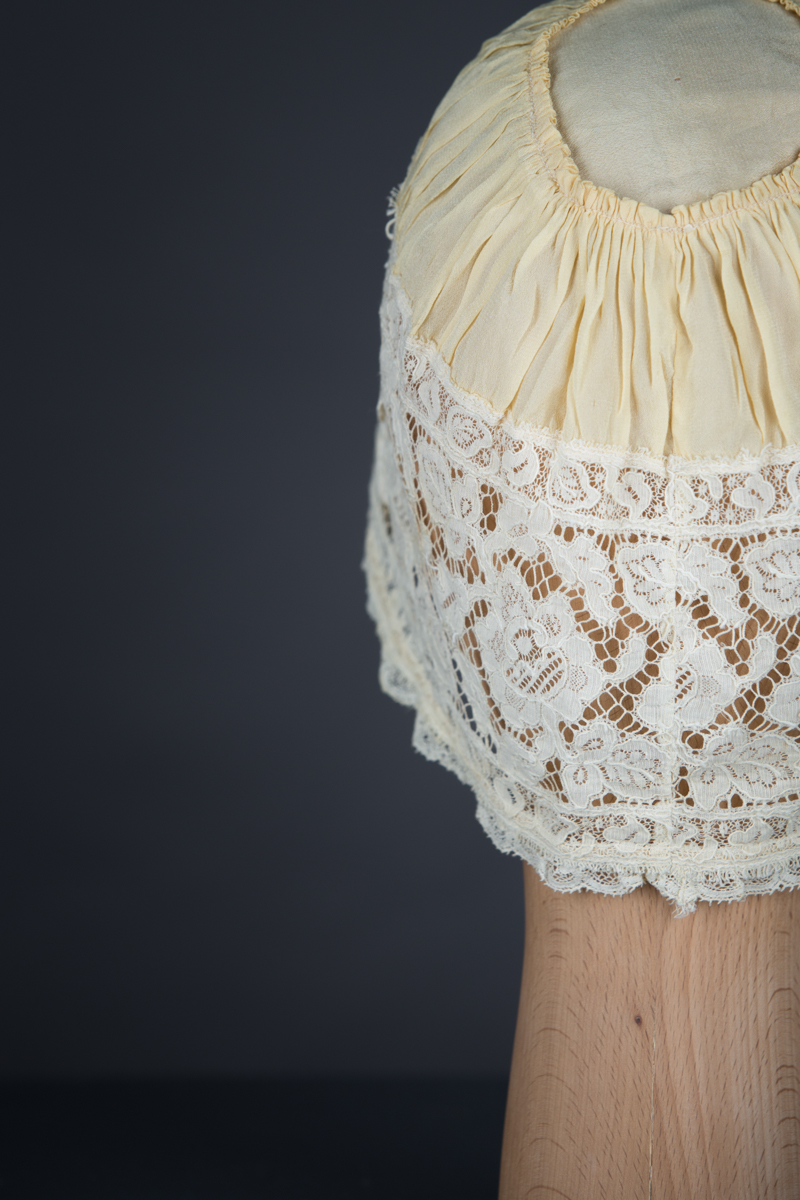Yellow Silk, Lace & Ribbonwork Bow Appliqué Boudoir Cap, c. 1910s, Great Britain. The Underpinnings Museum. Photo by Tigz Rice