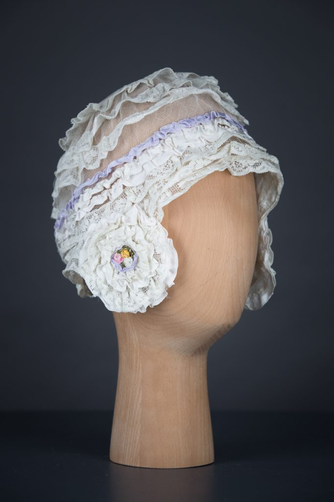 Cotton Leavers Lace Ruffle & Tulle Boudoir Cap With Silk Ribbonwork, c.1920s, UK. The Underpinnings Museum. Photography by Tigz Rice