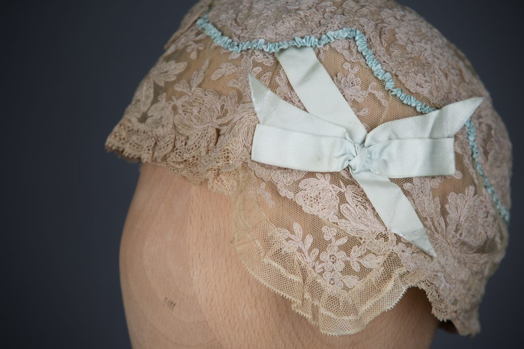 Lace & Silk Ribbonwork Boudoir Cap With Eau-De-Nil Bow, c. 1920s, UK. The Underpinnings Museum. Photography by Tigz Rice