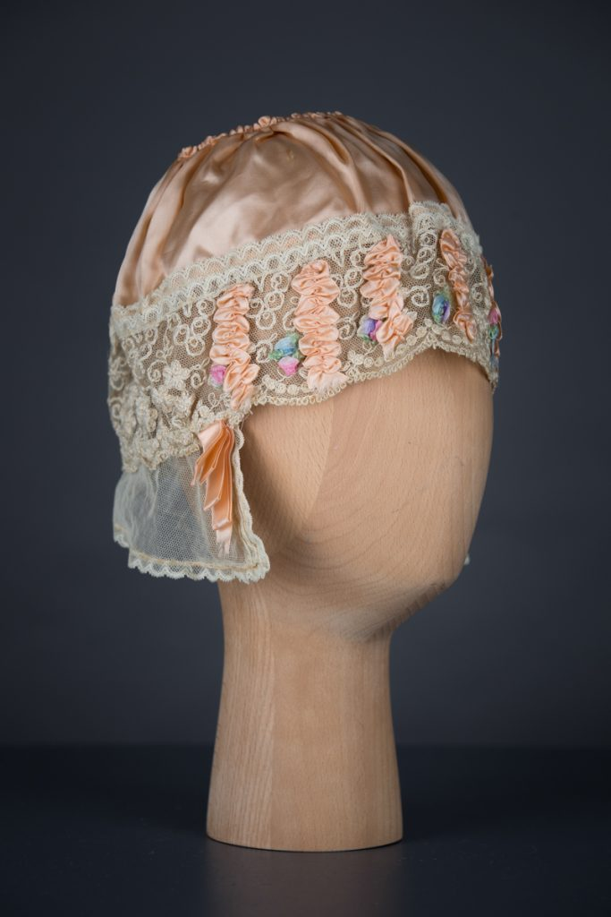Rayon Satin & Silk Ribbonwork Boudoir Cap, c. 1920s, UK. The Underpinnings Museum. Photography by Tigz Rice