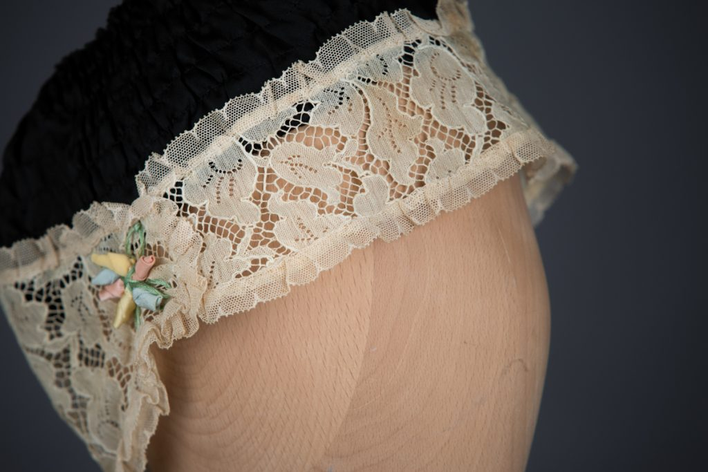 Shirred Black Silk & Ecru Lace Boudoir Cap, c.1920s, UK. The Underpinnings Museum. Photography by Tigz Rice