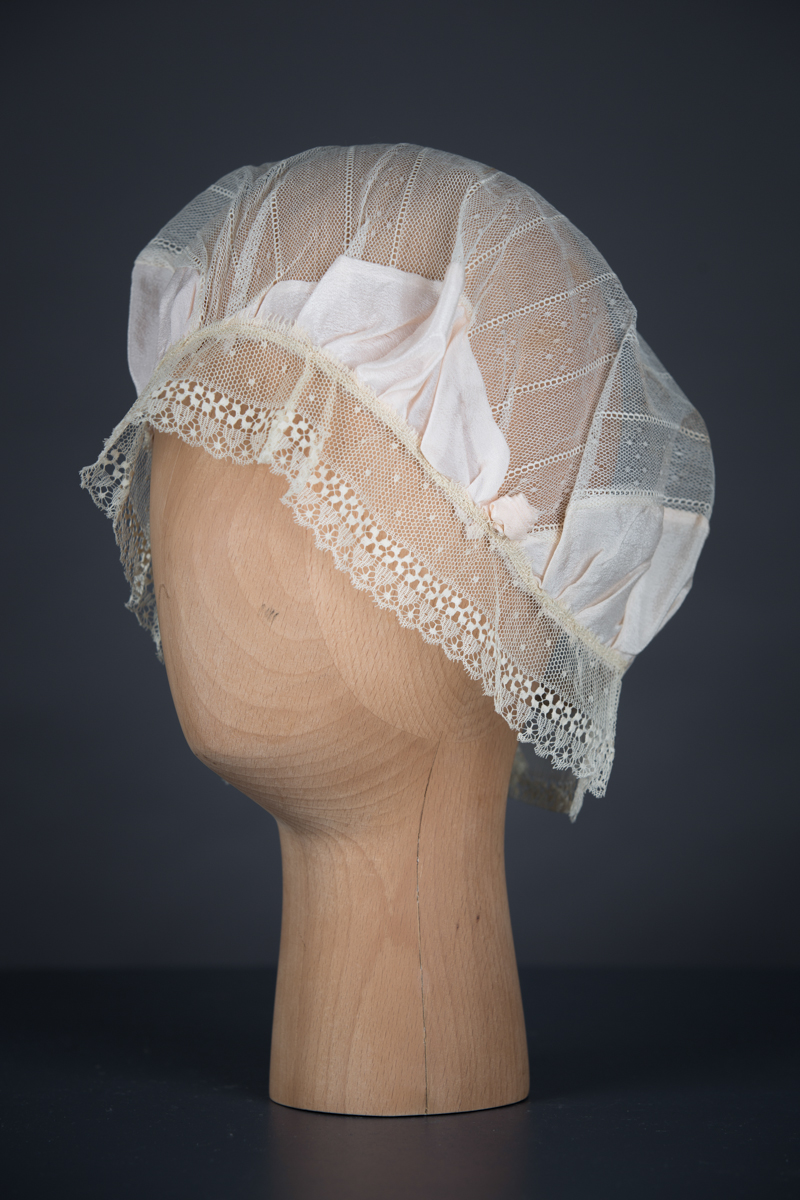Silk Habotai & Lace Boudoir Cap With Silk Rosettes, c.1920s, UK. The Underpinnings Museum. Photography by Tigz Rice