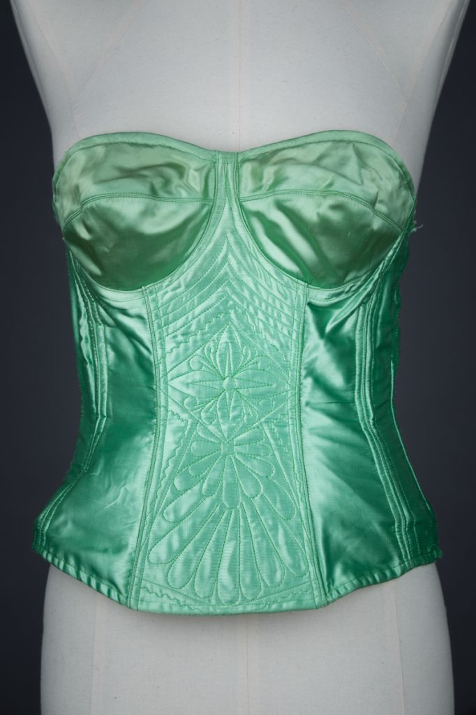 Green Rayon Satin Corselet With Freehand Quilting, c. 1950s, Poland. The Underpinnings Museum. Photography by Tigz Rice