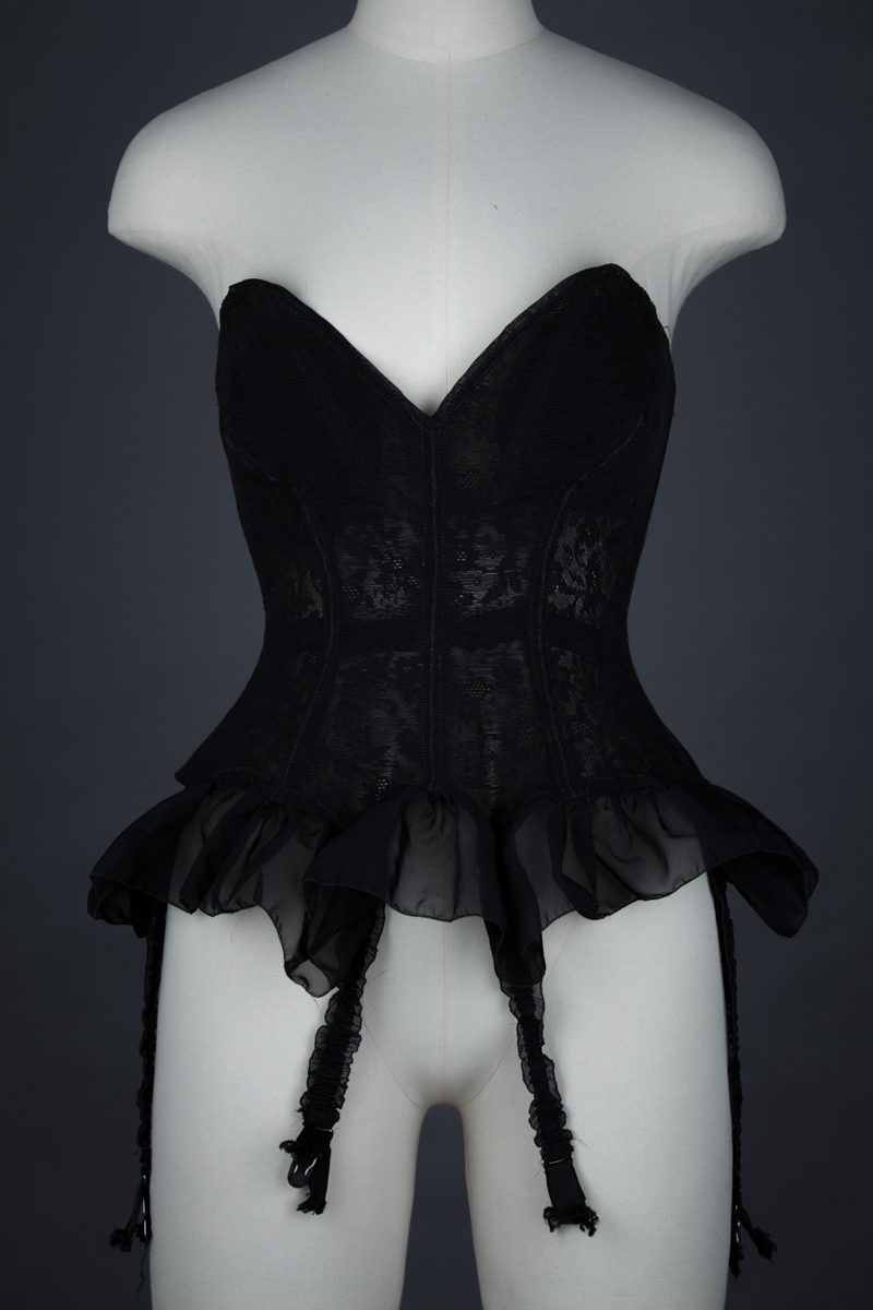 Black Floral Mesh Corselet With Nylon Flounce By Mador, c. 1950s, France. The Underpinnings Museum. Photography by Tigz Rice