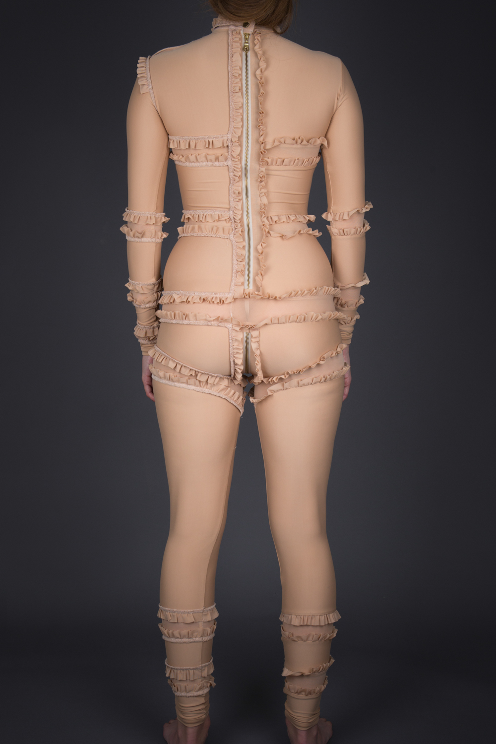 'Immodesty' Ruffled Jumpsuit by Rachel Freire, 2010, UK. The Underpinnings Museum. Photography by Tigz Rice.