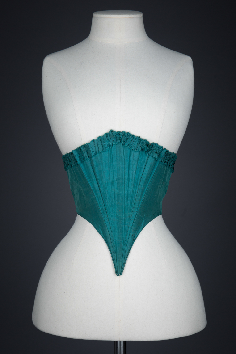 Green Silk Swiss Waist With Ruffled Trim, c. 1860s, USA. The Underpinnings Museum. Photography by Tigz Rice