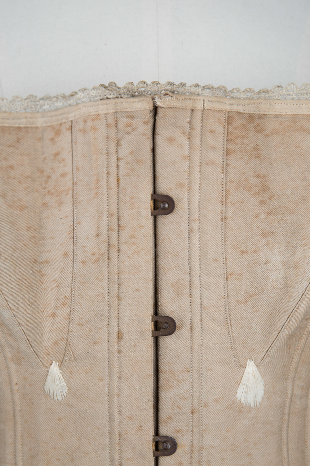 Ecru Cotton Twill Corset With Gores & White Flossing Embroidery, c. 1870s, Great Britain. The Underpinnings Museum. Photography by Tigz Rice.