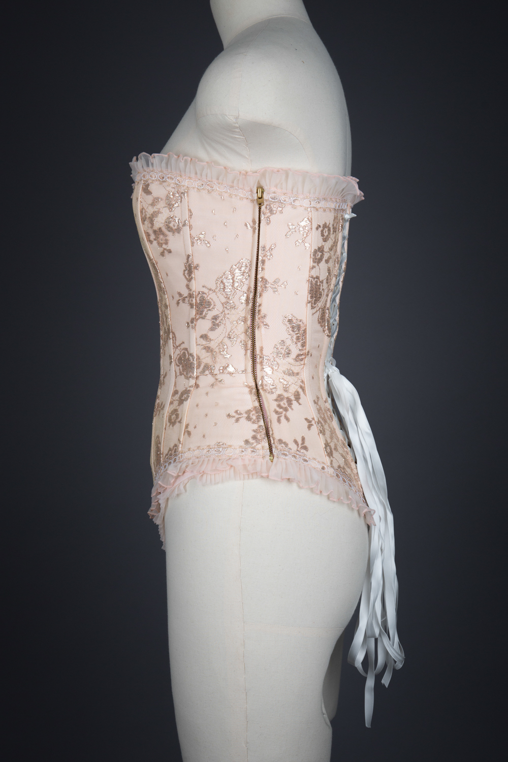 Peach Nylon With Metallic Lace Overlay Corset & Thong by Fifi Chachnil, 1998, France. The Underpinnings Museum. Photography by Tigz Rice.