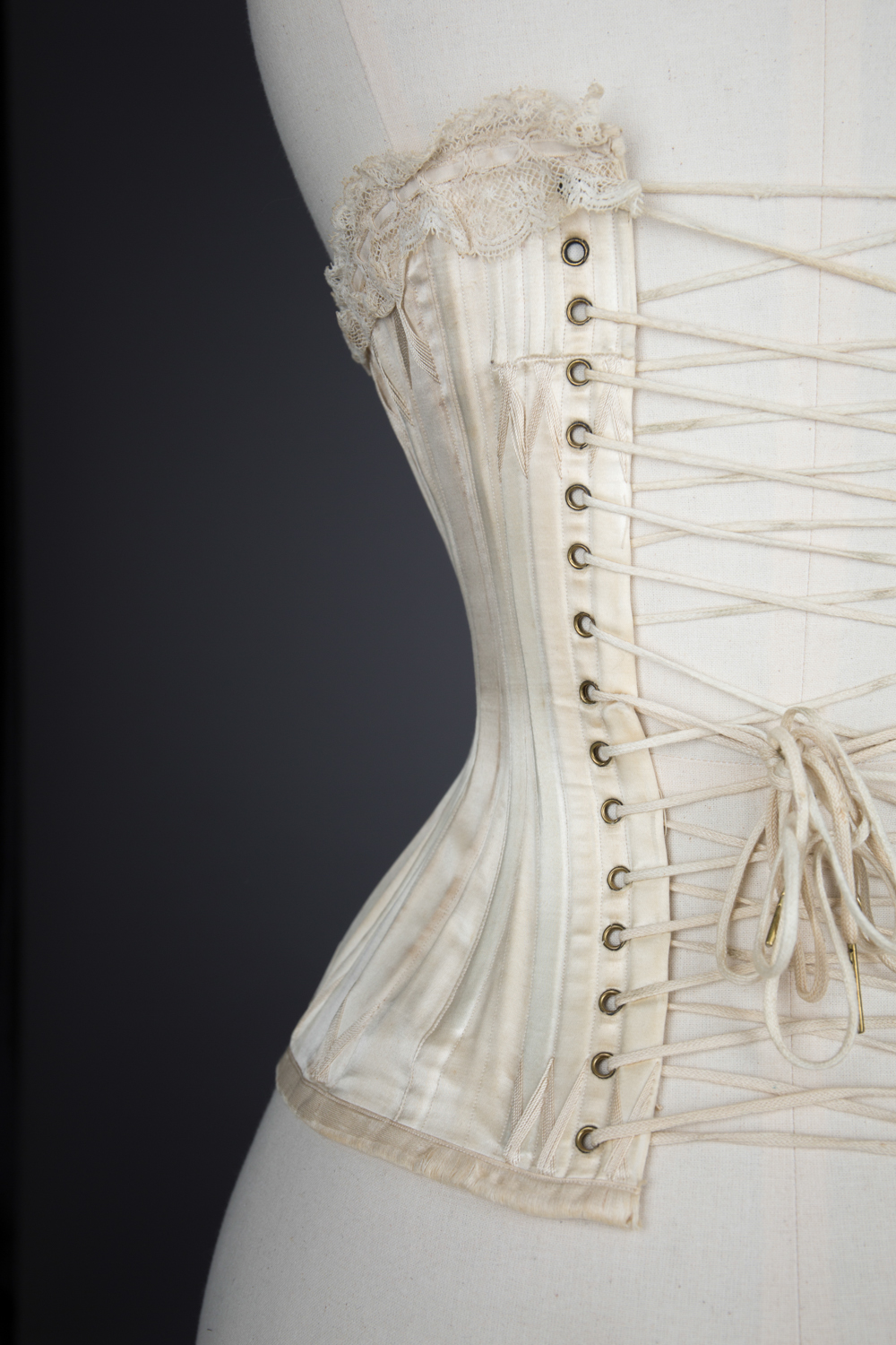 'Stella' Ivory Satin Corset With Flossing Embroidery & Cording by C. T., c. 1900, made in France for the USA market. The Underpinnings Museum. Photography by Tigz Rice.
