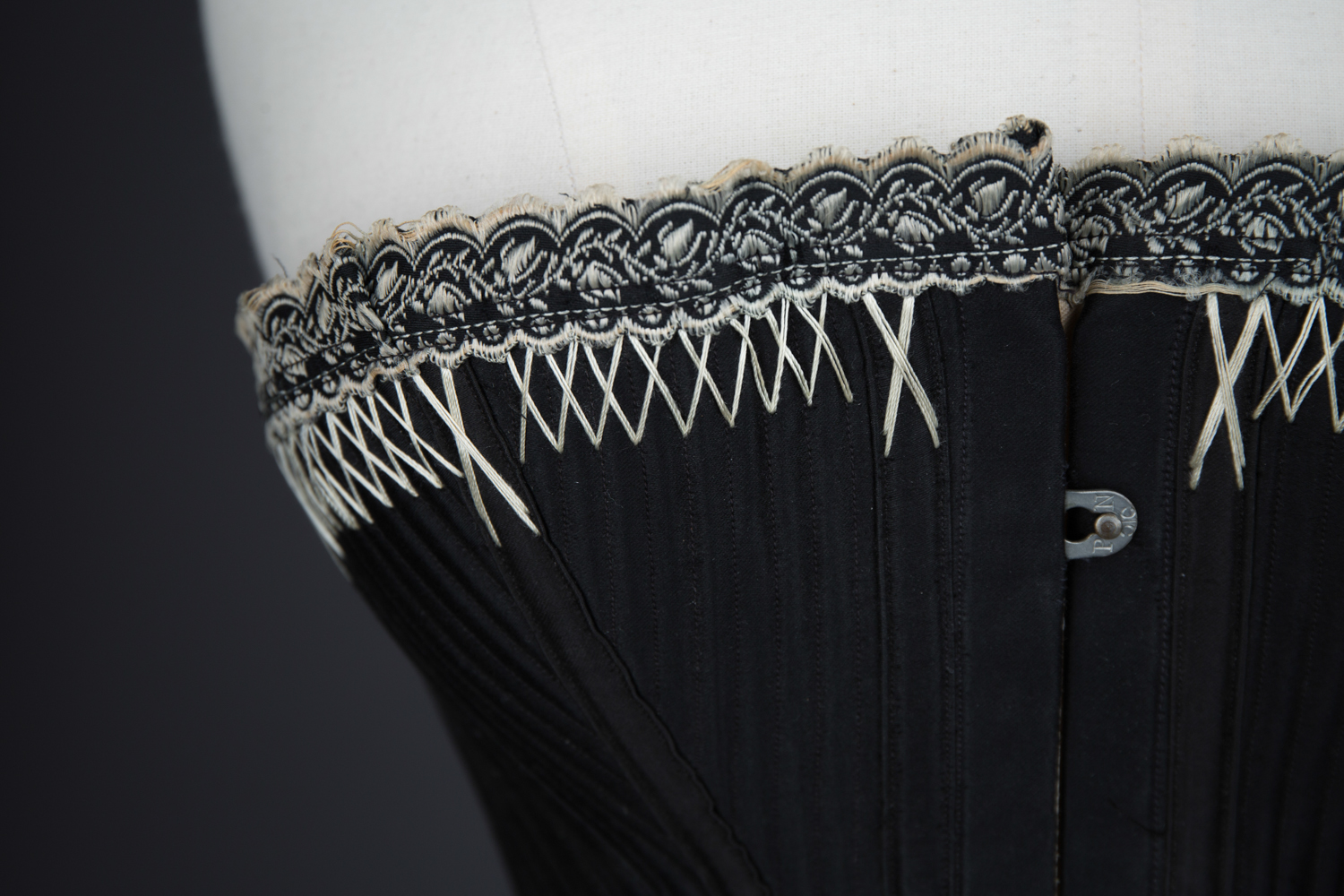 Black Cotton Sateen Corset With White Flossing & Woven Trim by P. N., C. late 1880s - early 1890s, USA. The Underpinnings Museum. Photography by Karolina Laskowska