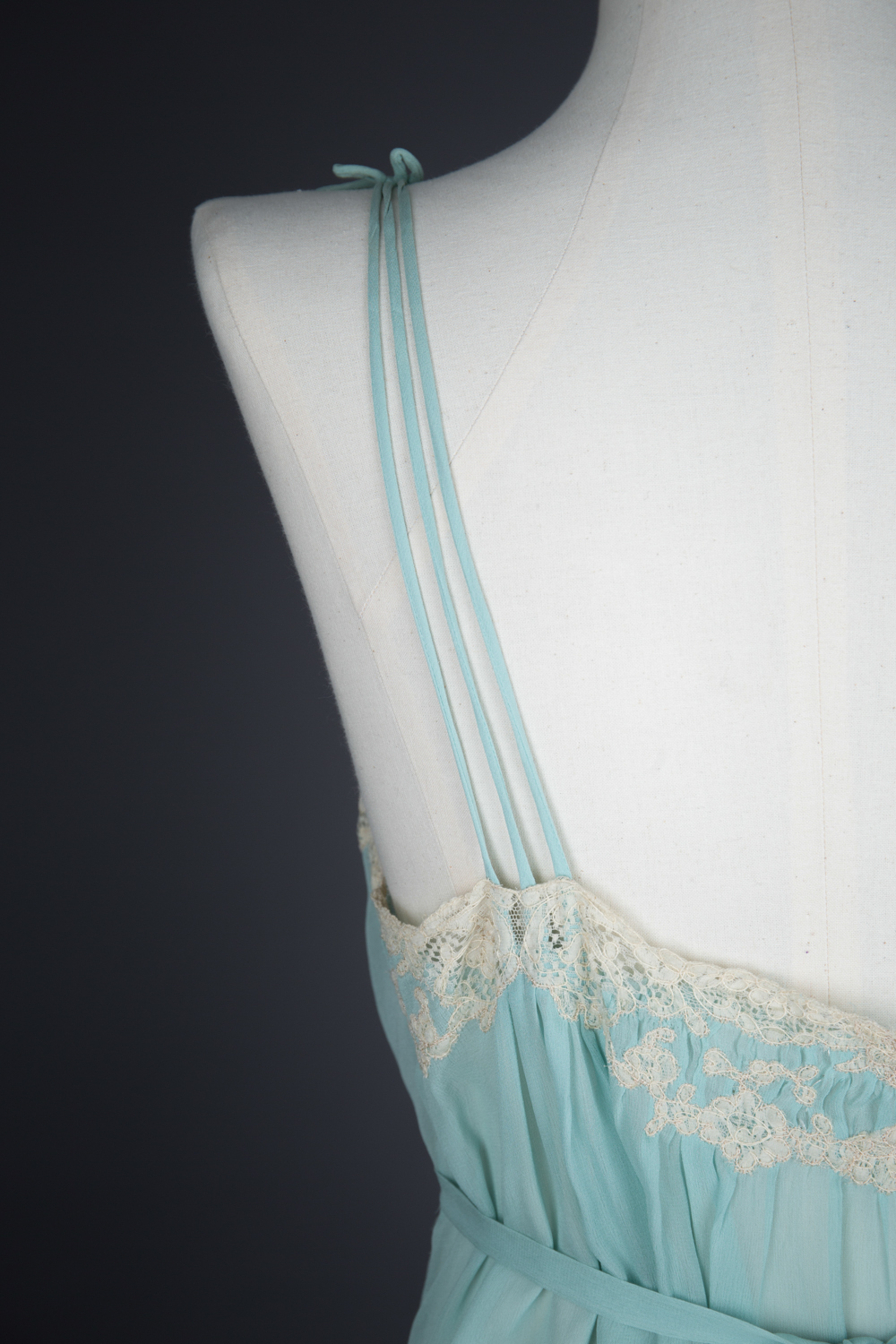Pleated Silk Georgette Gown With Lace Appliqué by Juel Park, c. 1940s, USA. The Underpinnings Museum. Photography by Tigz Rice.