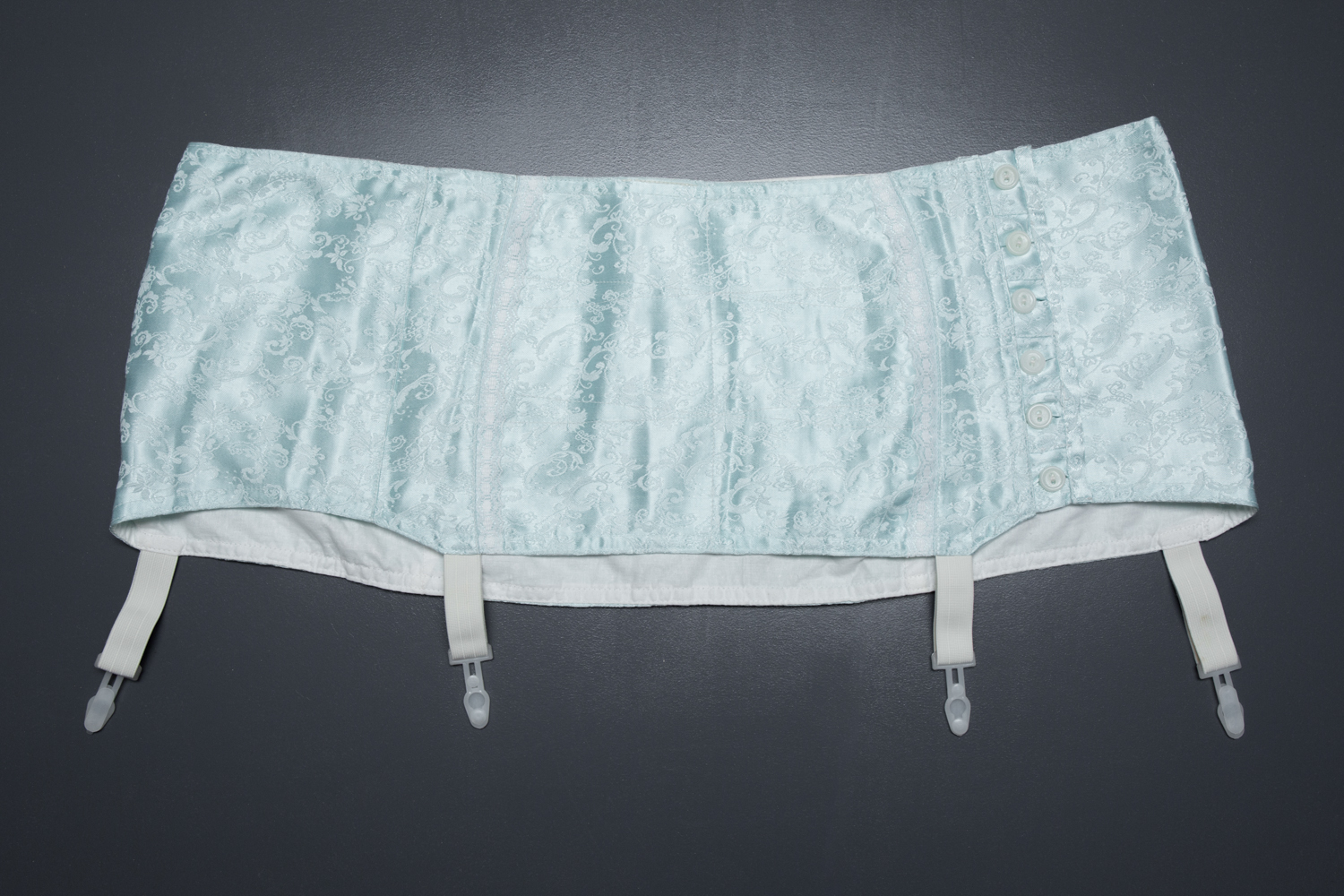 Homemade Pale Blue Jacquard Weave Suspender Belt With Plastic Garter Clips, c. 1950s, Russia. The Underpinnings Museum. Photography by Tigz Rice.