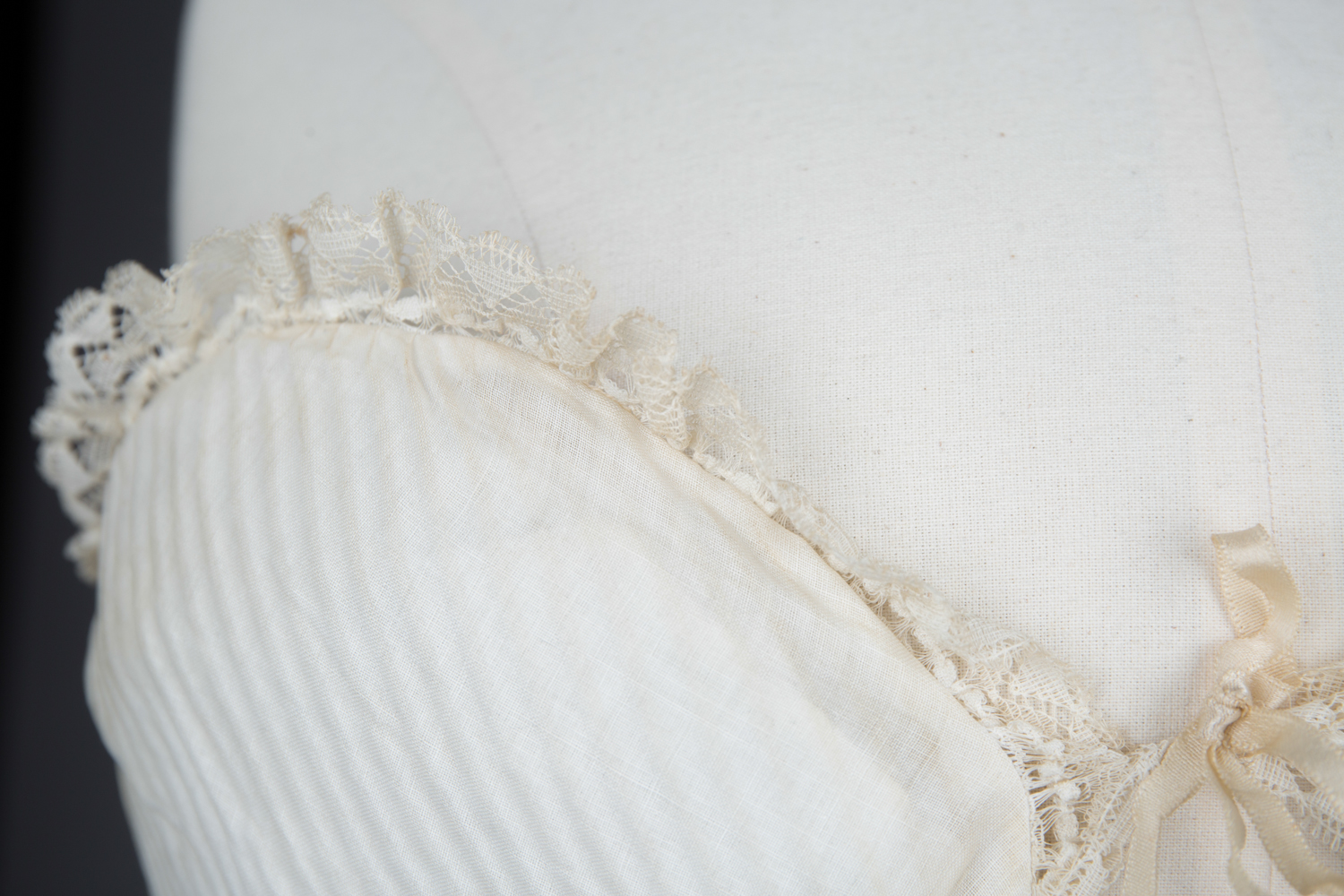 Cotton Padded Bust Improver With Lace Trim, c. 1880-1900s. The Underpinnings Museum. Photography by Tigz Rice.