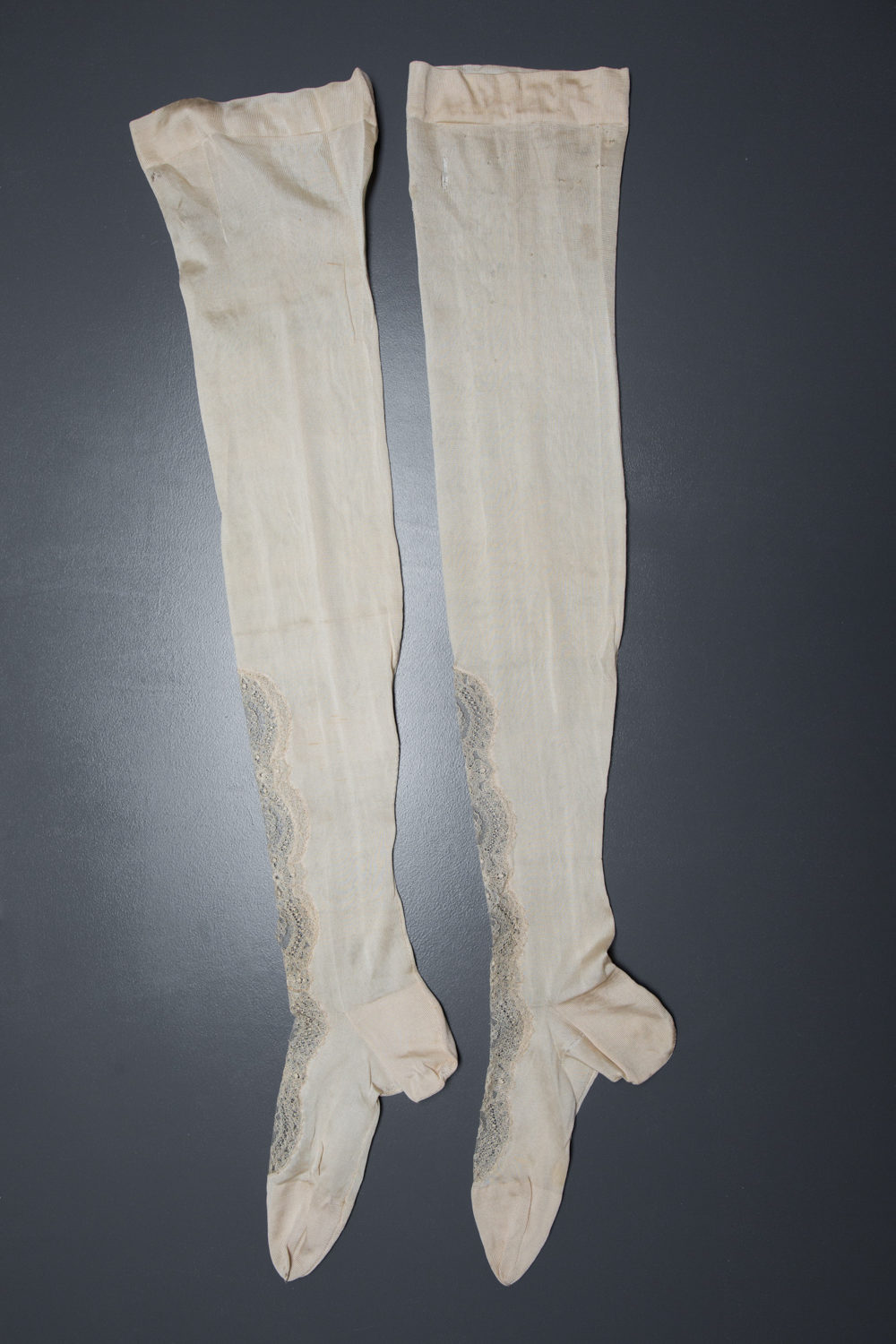 Cream Silk Stockings With Lace Inserts, c. 1900s, USA. The Underpinnings Museum. Photography by Tigz Rice