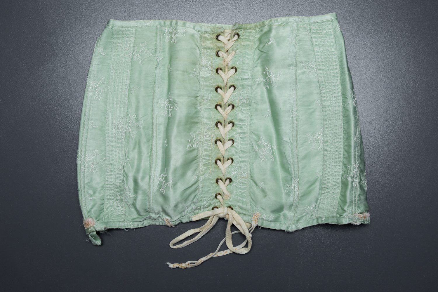 Short Green Brocade Girdle, c. 1920s, Russia. The Underpinnings Museum. Photography by Tigz Rice
