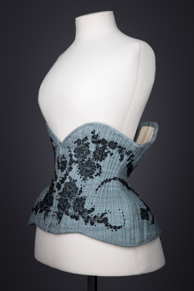 Blue Silk & Lace Appliqué Underbust Corset By Sparklewren, c. 2012, United Kingdom. The Underpinnings Museum. Photography by Tigz Rice.