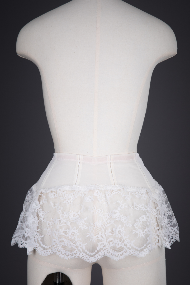 Ruffled Lace Trimmed Suspender Belt By Christian Dior, c. 1960s, France. The Underpinnings Museum. Photography by Tigz Rice.