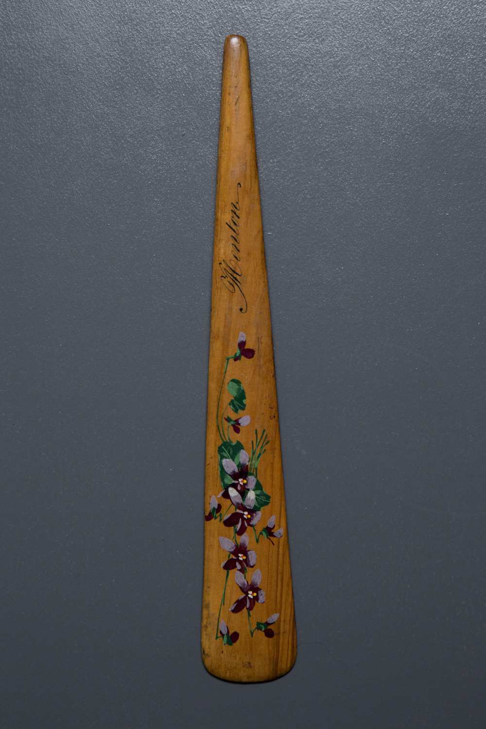 Hand Painted Souvenir 'Menton' Wooden Busk, c. 1850s, possibly France. The Underpinnings Museum. Photography by Tigz Rice