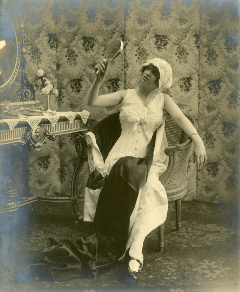 Early advertsing photograph of model wearing Spirella corset, c. 1914-1920, The Garden City Collection. FGCHM100.246.10a