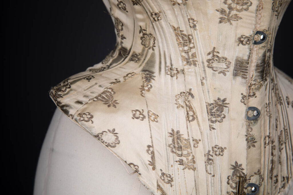 Metal & Silk Brocade Corset With Ribbonslot Lace Trim, c. 1900s. The Underpinnings Museum. Photography by Tigz Rice