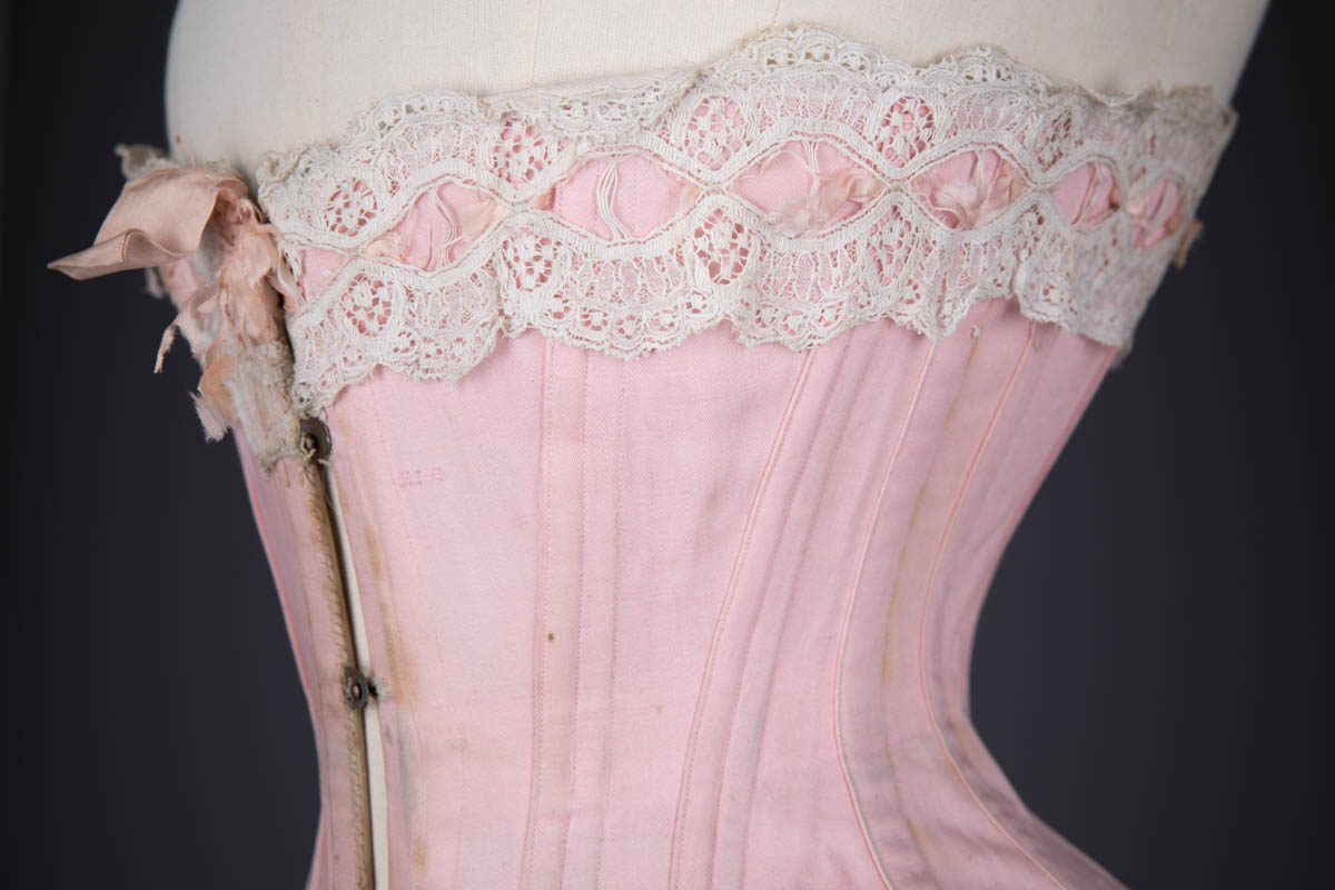 Pink Cotton Twill Longline Corset With Ribbonslot Lace Trim, c. 1910s, France. The Underpinnings Museum. Photography by Tigz Rice