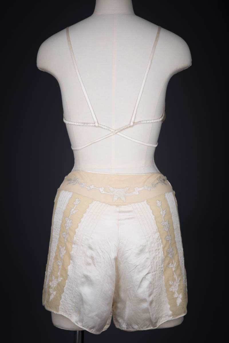 Ivory Silk Satin Embroidered Kestos Style Bra & Appliquéd Tap Pants, c. 1930s, Great Britain. The Underpinnings Museum. Photography by Tigz Rice