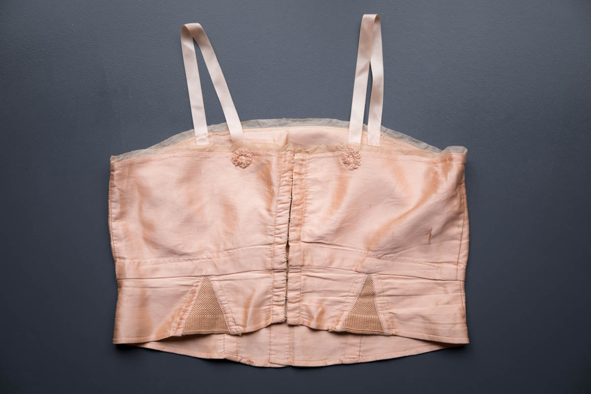 Pink Silk Bandeau Bra By Cadolle, c. 1920s, France. The Underpinnings Museum. Photography by Tigz Rice