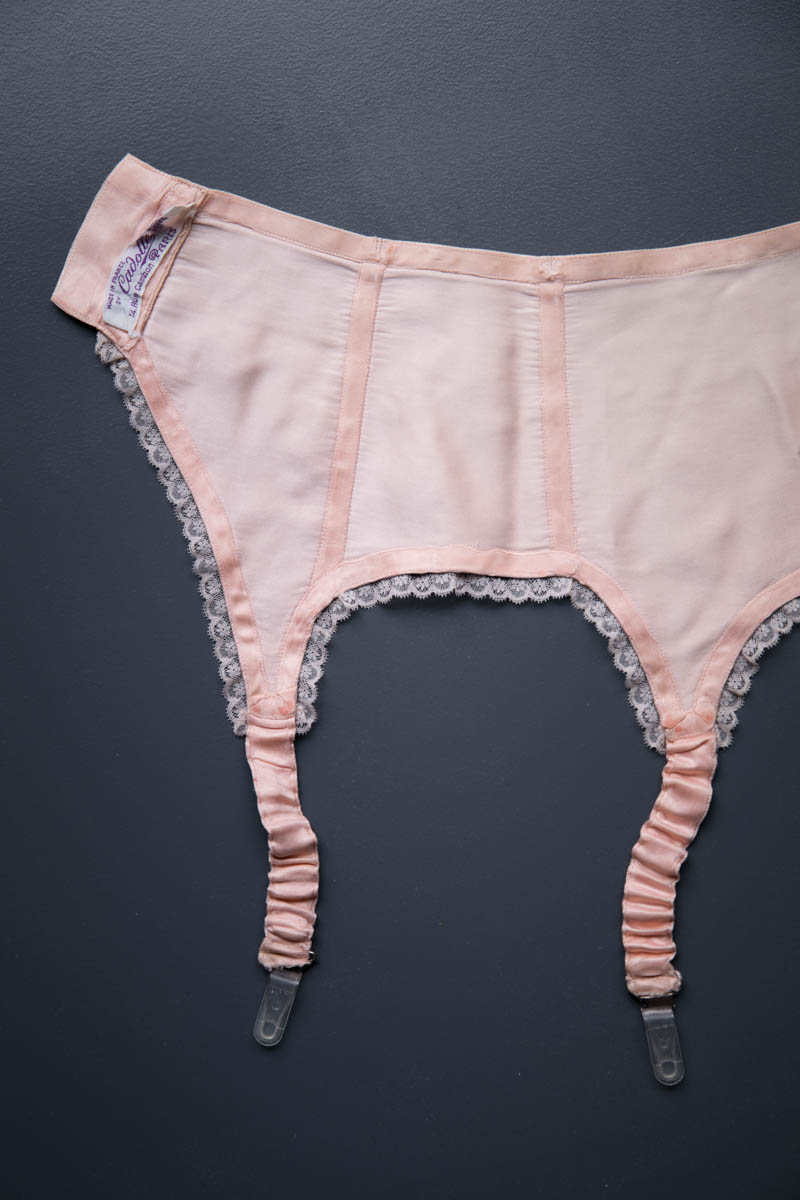 Silk Satin Lace Trimmed Suspender Belt By Cadolle, c. 1940s, France. The Underpinnings Museum. Photography by Tigz Rice
