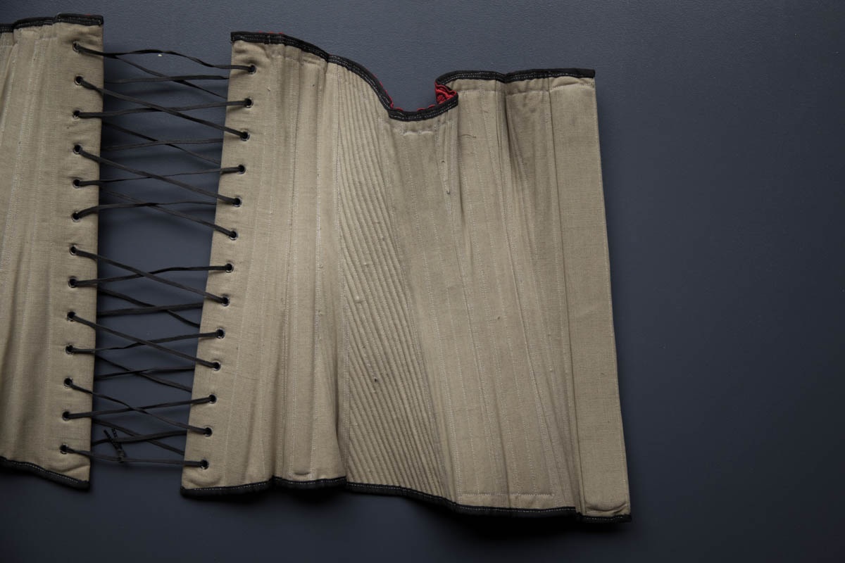 Black Cotton Sateen Corded Corset With Woven Trim, c. 1890s, Great Britain. The Underpinnings Museum. Photography by Tigz Rice.
